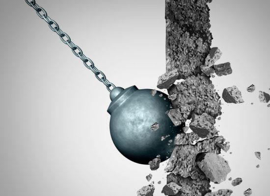 Wrecking ball hitting a brick wall